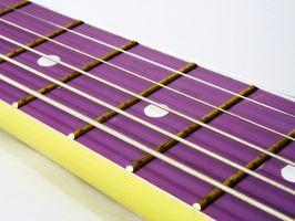 Cómo ajustar una guitarra de cuerdas más pesadas