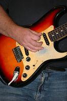 ¿Cómo jugar caída hacia fuera muchacho canciones en guitarra?