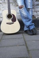 Cómo hacer una lijadora de banda de silla de montar de guitarra