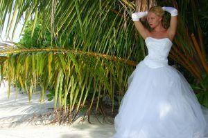 Estilos de vestido de novia para una forma de reloj de arena